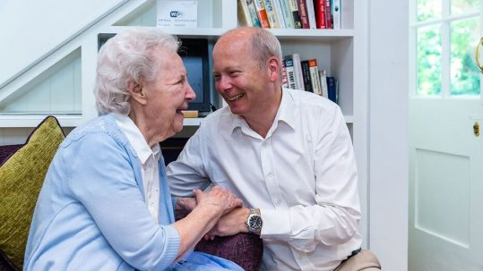 Time to consider a care home. David Tanner with a resident.
